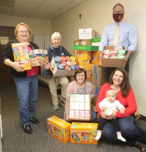 (Back left) Linda Trevorrow, Laura Root, Stow Mayor John Pribonic and (front left) Dinah Henderson, Annie Hanson Hilaire and daughter Lizzie Hilaire with boxes of cereal collected for the Bulldog Bags at Stow City Hall. Throughout April, the Rotary Club of Stow-Munroe Falls, along with the Stow-Munroe Falls High School Interact Club, collected cereal for Bulldog Bags, which collects and distributes food to district students in need.