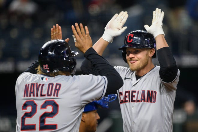Cleveland's Jake Bauers, right, celebrates his two-run home run with Josh Naylor during the eighth inning of a baseball game against the Kansas City Royals Tuesday, May 4, 2021, in Kansas City, Mo. (AP Photo/Reed Hoffmann)