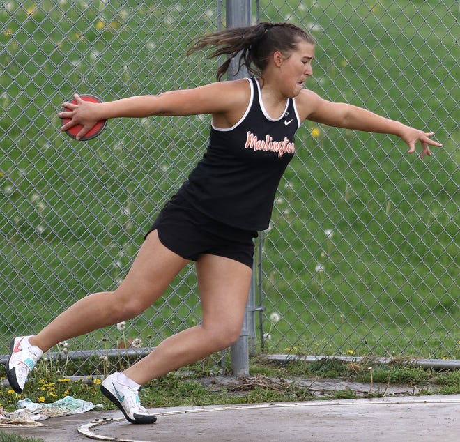 Lauren Keathley during a discus throw attempt at Marlington High School against Carrollton Tuesday, May 4, 2021.