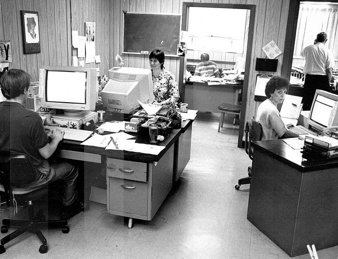 Times-Gazette employees at work in the newsroom in the East Second Street building in the early 1990s. Photo Provided
