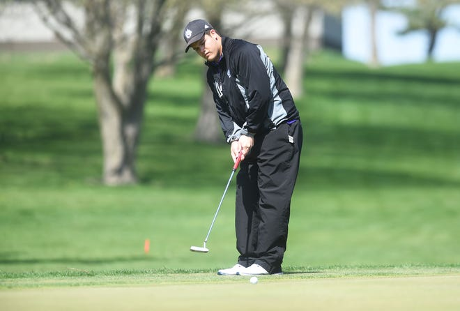 Nevada's Caden Jones putts the the ball onto the 10th hole during the Heart of Iowa Conference boys' golf meet Tuesday at the Lincoln Valley Golf Course in State Center. Jones won medalist by four strokes over PCM's Andrew Mitchell.