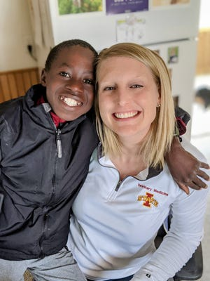 Kristen Obbink poses for a photo with her son Thomas Obbink, who joined the family through an international adoption.
