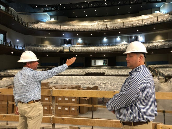 In this photo from October 2020, Columbia County Manager Scott Johnson (left) gestures toward a balcony while Columbia County Performing Arts Center General Manager Matt Jameson looks stage left while standing onstage inside the center's Ron C. Cross Theater.