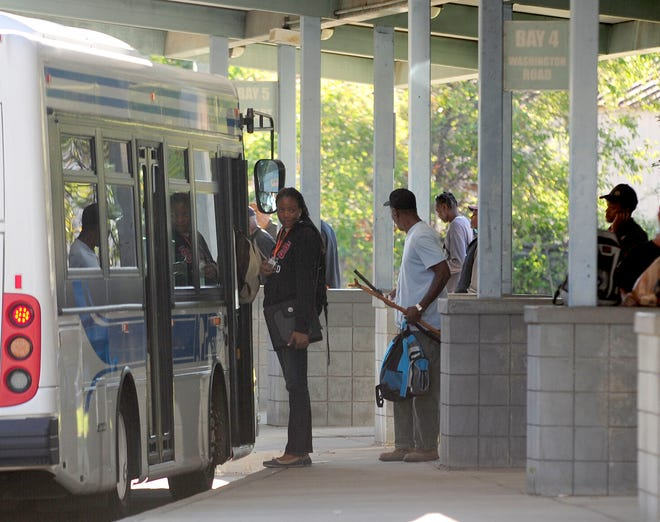 Bus riders board an Augusta Transit bus at the Broad Street Transfer Station. The station is hosting a vaccine clinic from 5:45-9:45 a.m. Thursday.