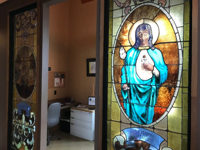 Stained glass salvaged from an 175-year-old Ohio church is part of a New Galilee structure for sale.