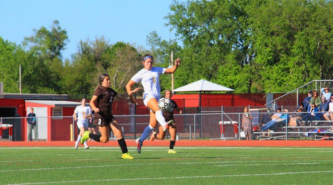 Circle senior, Kenzi Gillispie (1) kicks a ball towards the goal in the 4-0 win over Garden City on Thursday, May 4 at Wichita North High School in the annual North Cup. Gillispie would score one of her two goals on the play.