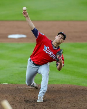 Wichita Wind Surge pitcher Josh Winder throws against the Springfield Cardinals is their season opening win.