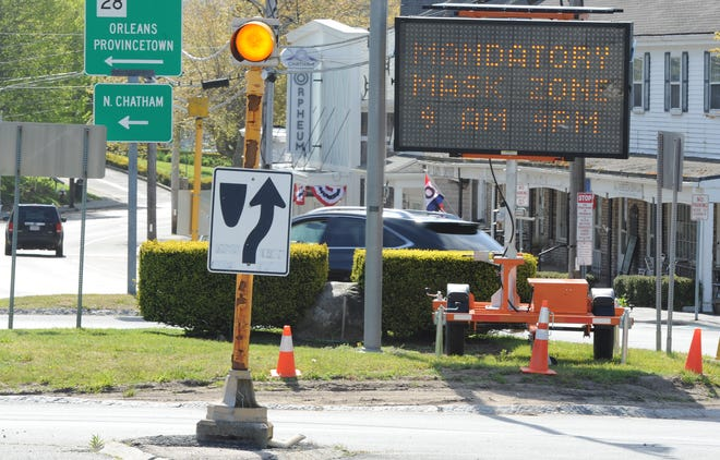 A sign alerting visitors last summer that downtown Chatham is a mandatory mask zone still applies after the Board of Health voted Monday to oppose Gov. Charlie Baker's decision to drop the state's outdoor mask requirement.