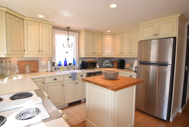 Built in 1969, 59 Beach Rose Lane in Brewster has had several updates, including new kitchen cabinets, a center  island and bamboo flooring. [COURTESY OF TRACEY ORINGER/KINLIN GROVER REAL ESTATE BREWSTER]