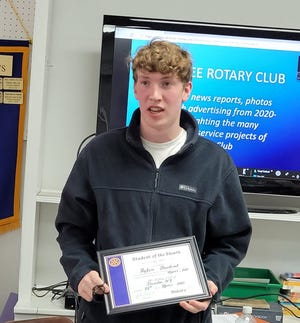 """The Student of the Month exemplifies the Rotary motto of """"Service Above Self."""" Peyton is pictured here telling the Dundee Rotary Club members of his plans to attend the University of Buffalo for aeronautical engineering."""
