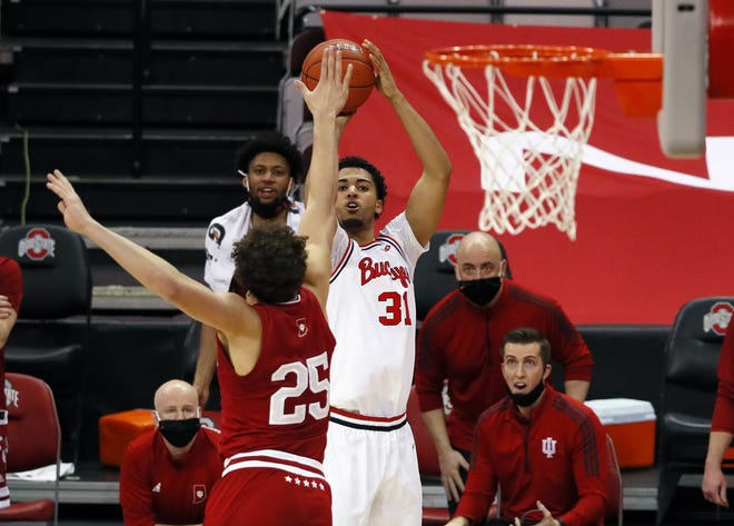 Ohio State Buckeyes forward Seth Towns (31) pulls up for a shot against Indiana Hoosiers forward Race Thompson (25) during the first half of their game at Value City Arena in Columbus, Ohio on February 13, 2021.