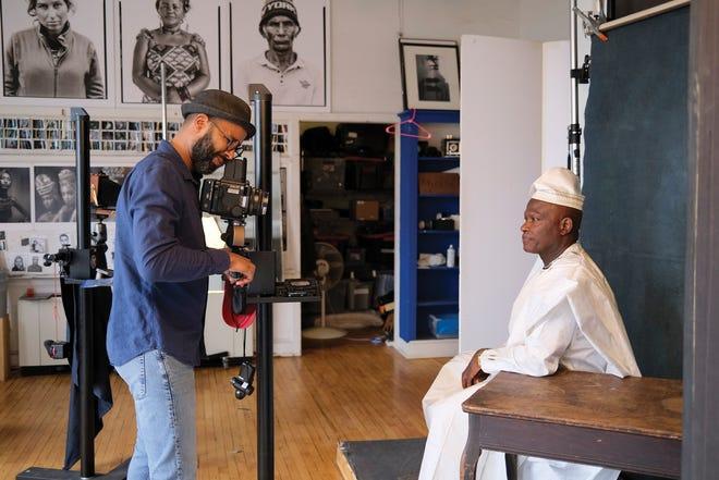Tariq Tarey photographs Papa Kalala in his studio.