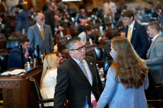"""Rep. Jerome """"Zee"""" Zeringue, R-Houma, chairman of the House Appropriations Committee, talks with a legislative staffer April 12 during the opening day of the Louisiana legislative session in Baton Rouge."""