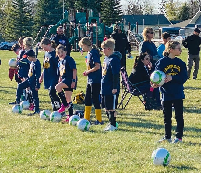 Players practice at the Crookston Youth Soccer Association's spring program which began Tuesday evening.