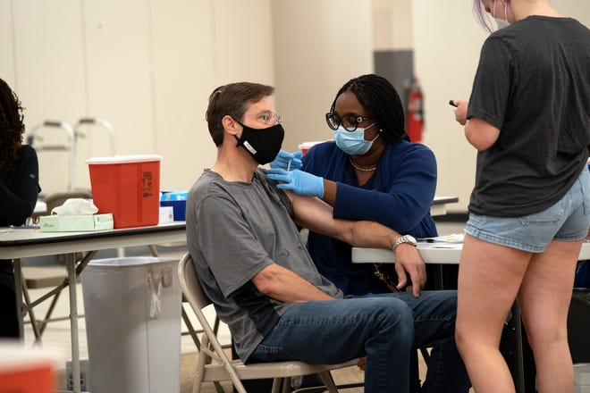 A man gets a COVID-19 vaccine at Lake Square Mall in Leesburg. [Cindy Peterson/Correspondent]
