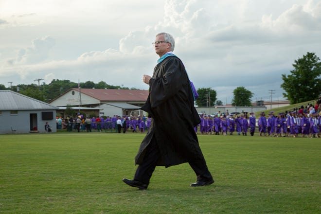 Columbia Central High School Principal Roger White walks into Lindsey Nelson Stadium in Columbia, Tenn., for the school's graduation ceremony on Tuesday, May 22, 2018.