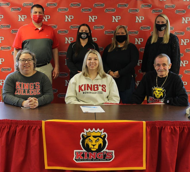 On her way to continue her academic and volleyball careers at Kings College is senior Emma Monson (front center). On hand to help her celebrate her commitment were her mother Carol Pallesen, and stepfather Svein Pallesen as well as Ron Collins, Principal, Alex Zero, Head Volleyball Coach, Mallory Mokay, Asst Volleyball Coach, Eliza Maganzini, Athletic Director.