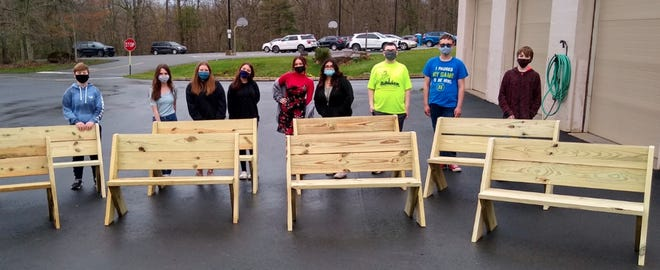 Eighth grade students at Wallenpaupack Area Middle School made these garden benches. From left: Andrew Geesey, Ofri Ezra, Breanna Conklin, Alyssa Collazo, Crystal Christianson, Isabella Earl, Aidan Beheran, Stephen Frey and Jacob Witten.