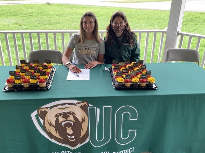 Union City senior Octavia Kosnik (left) and cross country coach Jeannette Boyd pose Wednesday after Kosnik signed a national letter of intent to run for Gannon University. Sabrina Kosnik, Octavia's older sister, formerly competed for the Golden Knights.