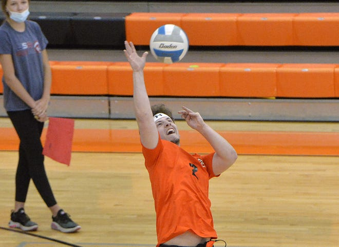 Cathedral Prep's Kyle Cox returns a shot against Fort LeBoeuf on May 4, 2021, inside the Joann Mullen Gymnasium, Hagerty Family Events Center, in Erie. Prep won the match 3-0.