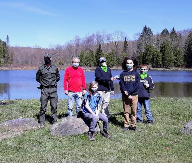 Members of Boy Scout Troop 1009 from Hornell and NYSDEC Ranger Justin Thaine help with the I Love My Park cleanup event in West Almond.