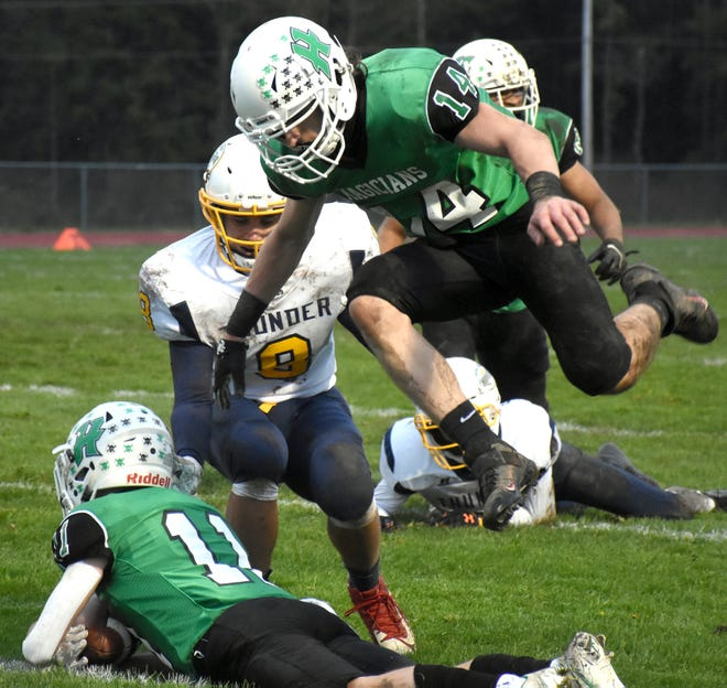 Herkimer Magician Dylan Hart jumps over teammate Kyle Annutto (11) after Annutto recovered a Central Valley Academy fumble at the start of the second quarter Tuesday.