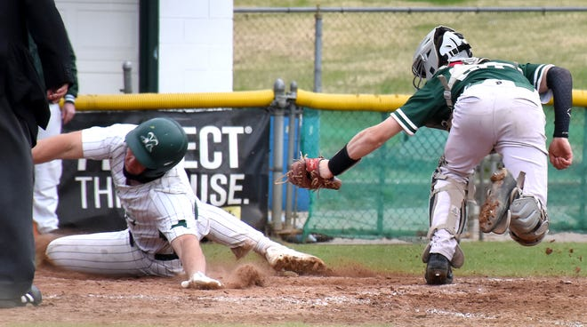 Herkimer College General Sal Carricato reaches back to touch home plate after sliding safely past Tompkins Cortland Community College catcher Christopher Pickert during an April 20 game at Veterans Memorial Park in Little Falls. The Generals will start their regional playoffs in Little Falls as a top seed Saturday.