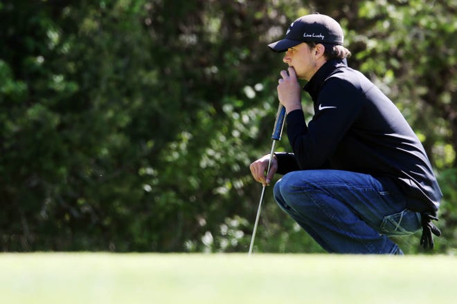 New London High School's Clayton Phillips eyes his putt during the SEISC boys golf tournament Wednesday May 5, 2021, at the Shearer Memorial Golf Course.
