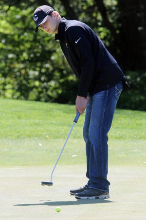 New London High School's Clayton Phillips putts during the SEISC boys golf tournament Wednesday at Sheaffer Memorial Golf Course.