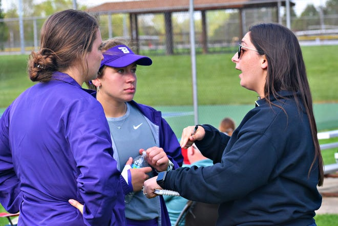 Burlington High School girls tennis coach Bailey Galvin (right) makes a point with Kayla Norton (center) and Jessica Kendell before their No. 1 doubles match at Dankwardt Park Tuesday night. Norton and Kendell defeated Notre Dame's Grace Kohkoff and Jackie Meeker, 8-4, and BHS won the dual meet, 8-1.
