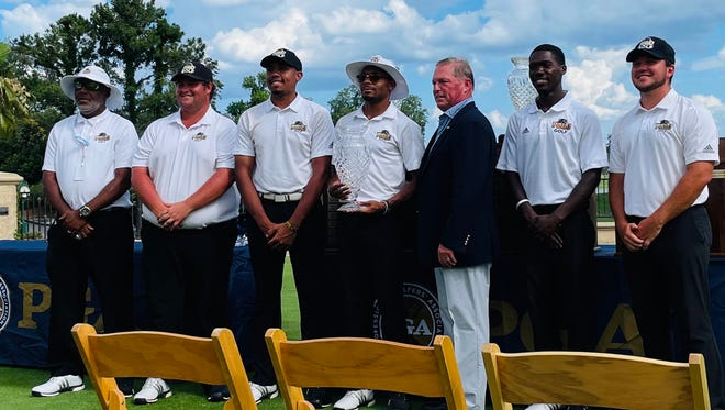 Prairie View A&M won the 34th annual PGA WORKS Collegiate Championship on Wednesday at the Stadium Course at TPC Sawgrass. They are with PGA of America president Jim Richerson.