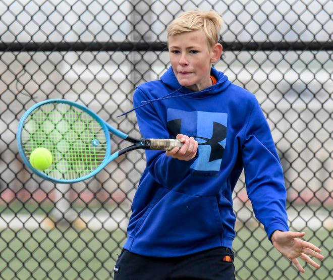 Garden City High School's Logan Morren hits a forehand shot during a singles match in april at the GCHS boys tennis tourney. Morren clamed the No. 1 singles title Tuesday in the WAC meet to help the Bufaloes win the team title. Morren was also chosen as the league's Player of the Year.