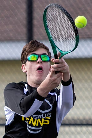 Galesburg High School junior Caleb Oxley hits a backhand return shot during a doubles match at the Silver Streaks' meet with Geneseo on Tuesday, May 4, 2021 at the Art Fish Memorial Courts.