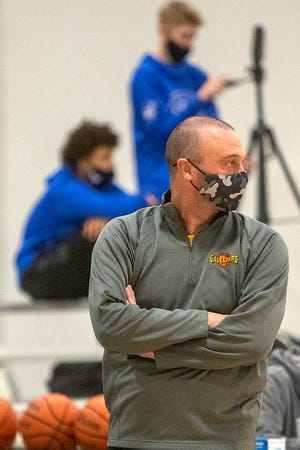 Galesburg HIgh School boys basketball coach Ryan Hart observes the action in a Western Big 6 game against Quincy on Friday, Feb. 19, 2021, at the GHS field house.