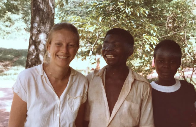 Racher Poller in Zaire with two local boys during her time serving as a Peace Corps volunteer from 1982-1984.