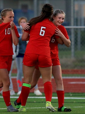 McPherson's Megan Everhart (16) is congratulated by teammate Belle Alexander (6) after she scored a goal against Buhler during their game Tuesday evening. McPherson defeated Buhler 3-1. To see more photos, go to www.hutchnews.com/sports