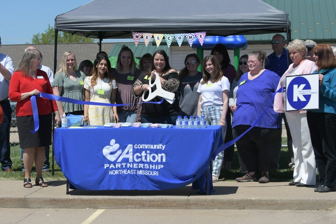 Tiffany Youngman, the center supervisor of the new Pfeiffer Avenue Early Head Start Center, cuts the ribbon at Wednesday's ceremony to celebrate the facility's opening.