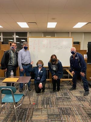 From left, Steve Cribley, Blue Ribbon Schools Committee treasurer; Martin Aho, school district treasurer; Kathryn Powers, superintendent; Tina Davis, school board president; and Rob Felber, school board member, during their watch party on May 4. They met at R.B. Chamberlin Middle School.