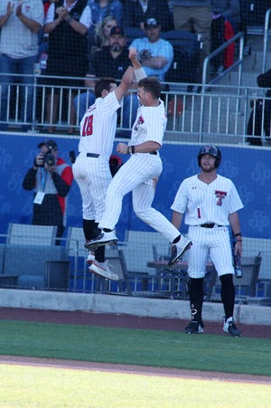 Texas Tech's Cole Stilwell (18) celebrates after hitting a two-run home run with Easton Murrell (19) in the first inning of a neutral-site, nonconference game Tuesday against Oklahoma at HODGETOWN Stadium in Amarillo. [Michael C. Johnson /For A-J Media]