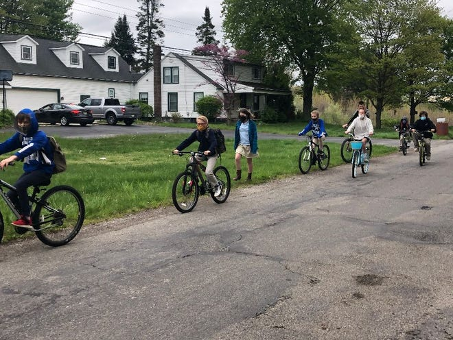 Students from Holy Ghost Lutheran School rode their bikes to school Wednesday morning as part of National  Bike to School Day.