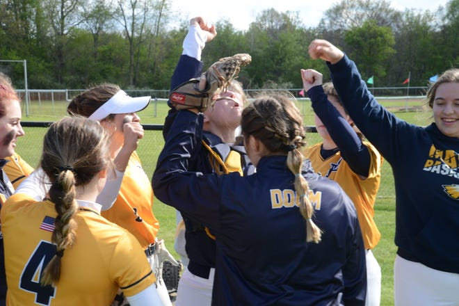 Erie Mason's softball players cheer after winning the first game of a doubleheader at Summerfield Wednesday.