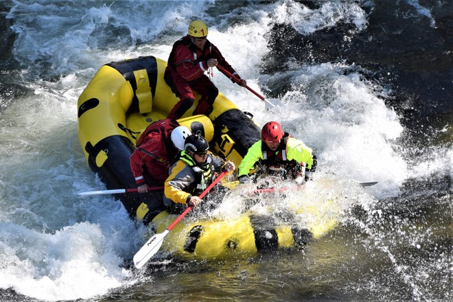 Firefighters from different local agencies called Siskiyou County Water Rescue Team train together in a swift water rescue class using their newly acquired boat. Learning how to navigate through swift water effectively will save lives.