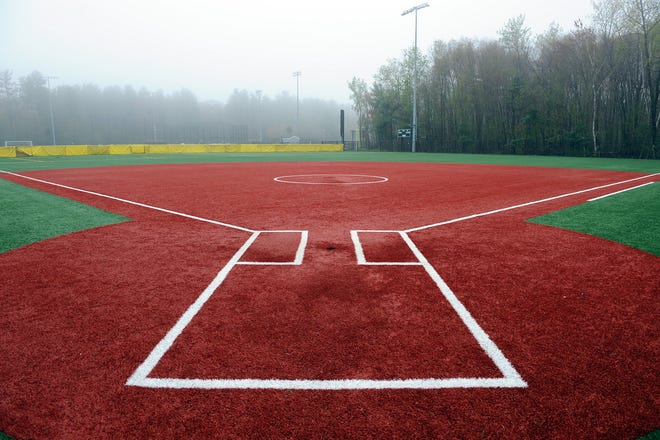 The Hopkinton High School softball field gets rained on, May 5, 2021.