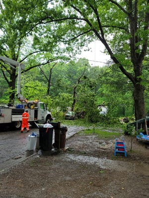 Repair crews work on storm damage in Oak RIdge during a power outage three months ago. The city's new electric department director explained to City Council the reasons for many of the power outages in the city over the last several months.