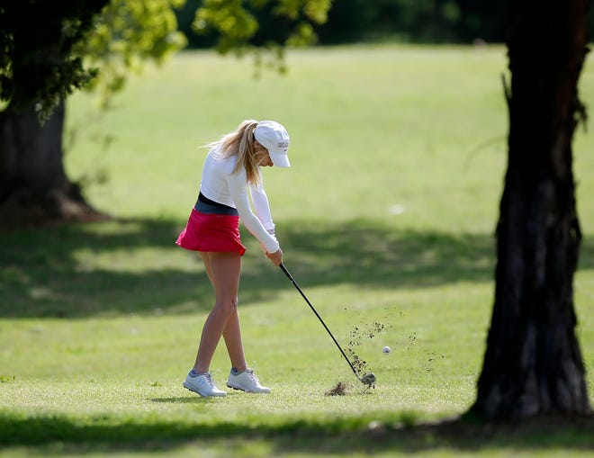 Christian Heritage's Layne Miller hits on the 10th hole during the Class 2A girls state golf tournament at Cimarron National Golf Club in Guthrie on May 5.