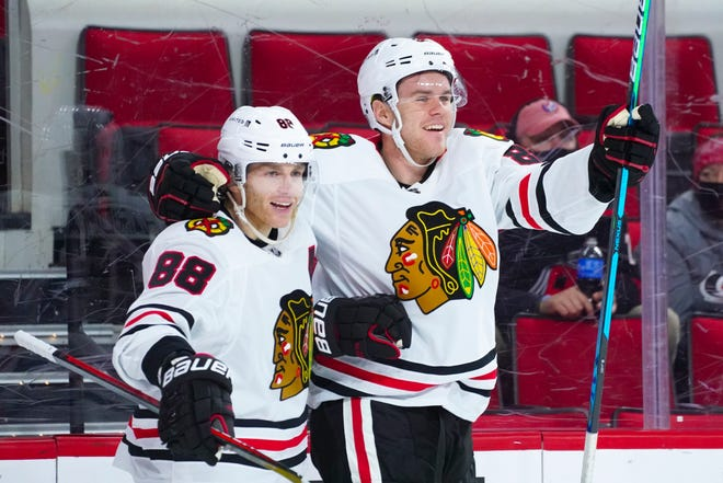 Chicago Blackhawks right wing Mike Hardman (86) celebrates his first career NHL goal with right wing Patrick Kane (88) against the Carolina Hurricanes at PNC Arena on Tuesday, May 4, 2021.