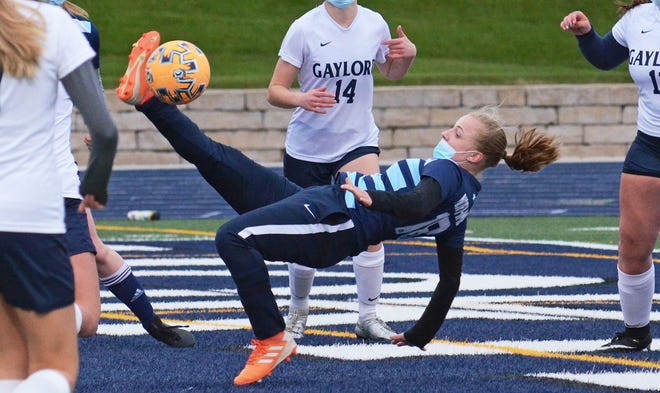 Petoskey's Hayley Flynn tries for a bicycle kick near the Gaylord goal while surrounded by Blue Devil defenders.