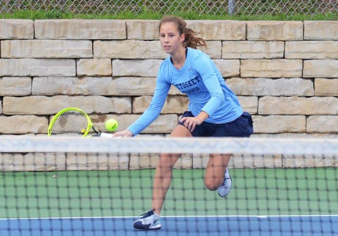 Petoskey's Annabel Wilcox of No. 4 singles attacks the net against her TC Central opponent on Tuesday.