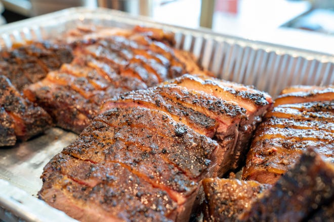 Prime brisket sliced and ready for a catering order at the Tropical Smokehouse in West Palm Beach.