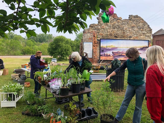 """On the right, Prince George Master Gardener Becky Joyner provides gardening advice to Jan Ferguson during the Historic Petersburg Foundation's """"All Things Garden"""" event at the Peter Jones Trading Station on April 24, 2021."""